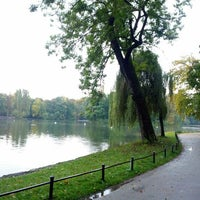 Photo taken at Kleinhesseloher See by Duc N. on 10/9/2012