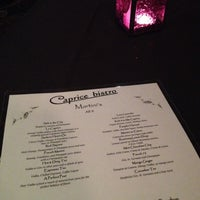Photo taken at Caprice Bistro by Kristin W. on 11/21/2012