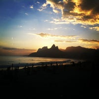 Photo taken at Pedra do Arpoador by Anderson P. on 3/3/2013