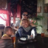 Photo taken at Rumah Kayu Resto & Cottage by Zan S. on 1/11/2014