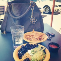 Photo taken at Café Yumm! by Amber S. on 7/24/2013