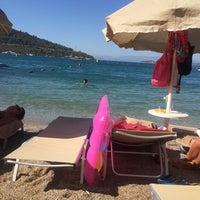 Photo taken at Izer Beach by Melih ö. on 8/16/2016