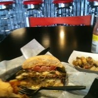 Photo taken at Mojo's Famous Burgers and More by Becky P. on 5/16/2013