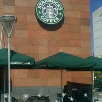Photo taken at Starbucks by Lindoro C. on 11/18/2012