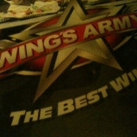 Photo taken at Wings Army by Marvin M. on 12/27/2012