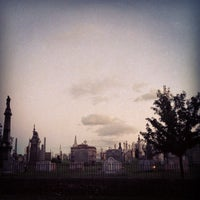 Photo taken at New Calvary Cemetery by Kira D. on 9/23/2013