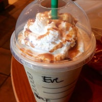 Photo taken at Starbucks by Eve Y. on 1/18/2013