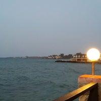 Photo taken at Calamari Restaurant by Ebru Ç. on 7/16/2013