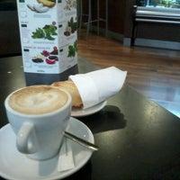 Photo taken at Kenyan Classic Coffee by Alex B. on 12/11/2012