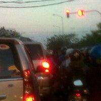 Photo taken at Perempatan Kedung Cowek by iskar n. on 9/18/2012