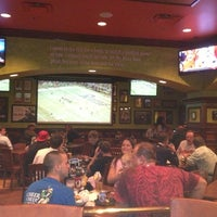 Photo taken at Tilted Kilt Pub & Eatery by Jim F. on 10/5/2012