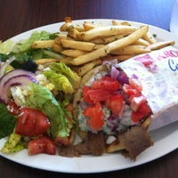 Photo taken at Mikonos Grill by Baron R. on 6/21/2013