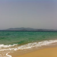 Photo taken at Plaka Beach by Thodoris D. on 5/18/2013