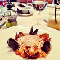 Photo taken at Quattro Gastronomia Italiana by Viviane S. on 4/28/2013