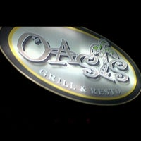 Photo taken at Oasis Bar and Grill by Dimple C. on 12/26/2012