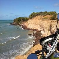 Photo taken at Praia de Cotovelo by Mirni F. on 4/10/2013