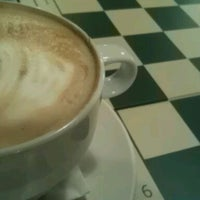 Photo taken at Cafe Milo by Ben T. on 12/14/2011