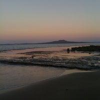 Photo taken at Mairangi Bay Beach by Sharon V. on 4/12/2011