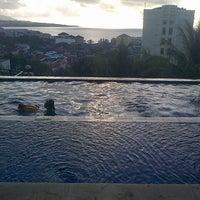 Photo taken at Hotel Minahasa by Anastasia M. on 3/1/2014