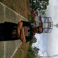 Photo taken at Tugu Katulistiwa (Equator) by Ridwan W. on 1/26/2013
