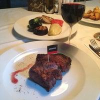 Снимок сделан в AMbar Steak House пользователем Irina P. 7/14/2013