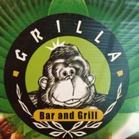 Photo taken at Grilla Bar and Grill by Karina R. on 3/8/2013