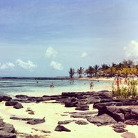 Photo taken at Mont Choisy Beach by Andr? L. on 1/5/2013