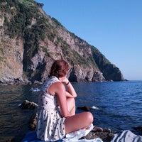 Photo taken at Spiaggia di Riomaggiore by Evgeny S. on 7/27/2013
