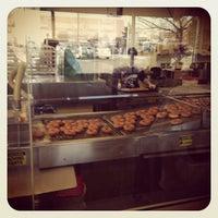 Photo taken at Krispy Kreme Doughnuts by Bud H. on 12/30/2012