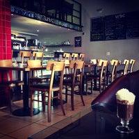 Photo taken at Urbe Café Bar by Dimitri P. on 5/8/2013