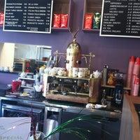 Photo taken at Royale Cafe Vinoteca by Sam S. on 4/29/2013