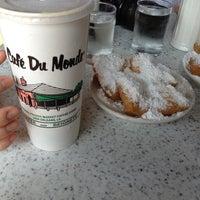 Photo taken at Café du Monde by Josh W. on 5/24/2013
