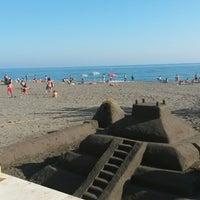 Photo taken at Playa Ferrara by Ana C. on 4/17/2014