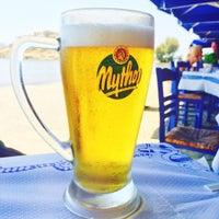 Photo taken at Agios Prokopios Beach by Daphne G. on 8/6/2015
