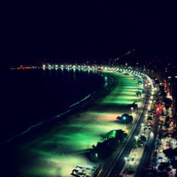 Photo taken at Copacabana Beach by TM H. on 6/30/2013