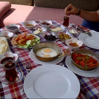 Photo taken at Osmanlı Kahvaltı Bahçesi / Ottoman Garden Breakfast by orhan gazi ç. on 5/12/2013