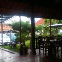 Photo taken at Waroeng woloe Pasuruan by Inri L. on 6/1/2013