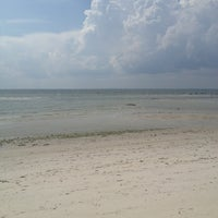 Photo taken at Little Island Beach by Ally G. on 7/24/2013