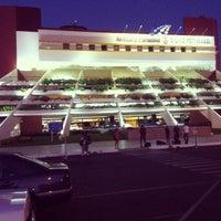 Photo taken at Aeropuerto Internacional Silvio Pettirossi (ASU) by Estevao R. on 12/23/2012