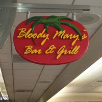 Photo taken at Bloody Mary's Bar & Grill by Maribeth Y. on 12/18/2012
