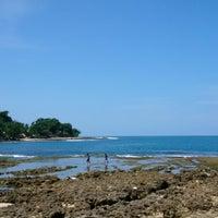 Photo taken at Rancabuaya Beach by Radewa P. on 3/28/2015