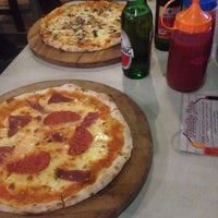 Photo taken at Warung PePe Wood Fired Pizza & Pasta by Cato C. on 4/18/2017