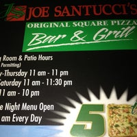 Photo taken at Joe Santucci's Square Pizza Bar and Grill by Becky A. on 12/6/2012