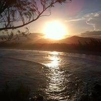 Photo taken at Praia da Ferrugem by Kely C. on 3/1/2013