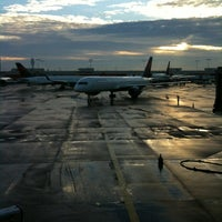 Photo taken at Gate T4 by Amy G. on 10/18/2012