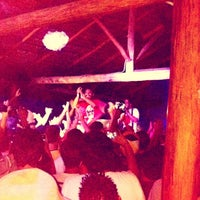 Photo taken at Bananas Beach Club by Júlia D. on 2/23/2014