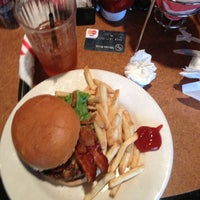 Photo taken at TGI Fridays by Caitlin C. on 11/7/2012