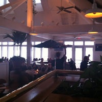 Photo taken at Rick's Cafe Boatyard by Kelly G. on 4/19/2013