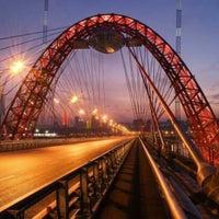 Photo taken at Zhivopisny Bridge by Julie on 7/2/2013