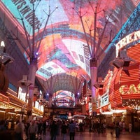 Photo taken at Fremont Street Flightlinez by Julie on 7/4/2013